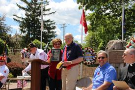 Mayor Schwager presents Grand Marshall Jack Bruni with a plaque