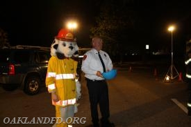 Sparky and Chief LeRoy about to pick the door prize winners