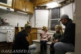 OVFD member Michelle talks to a family about house safety