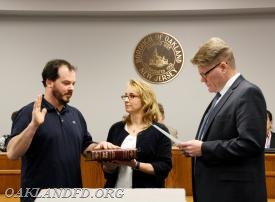 Eric DeGrosa receives his Oath of Office from Councilman Kulmala