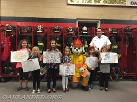 Assistant Chief Gary Walker with some of the poster contest winners