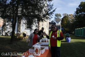 Public Events Committee Chairman Thomas Russo and Committee members Staci Zeller and Pat Pignatelli serve refreshments