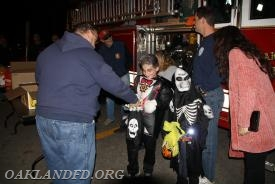 Fireman Dan D'Elia hands out candy and chips