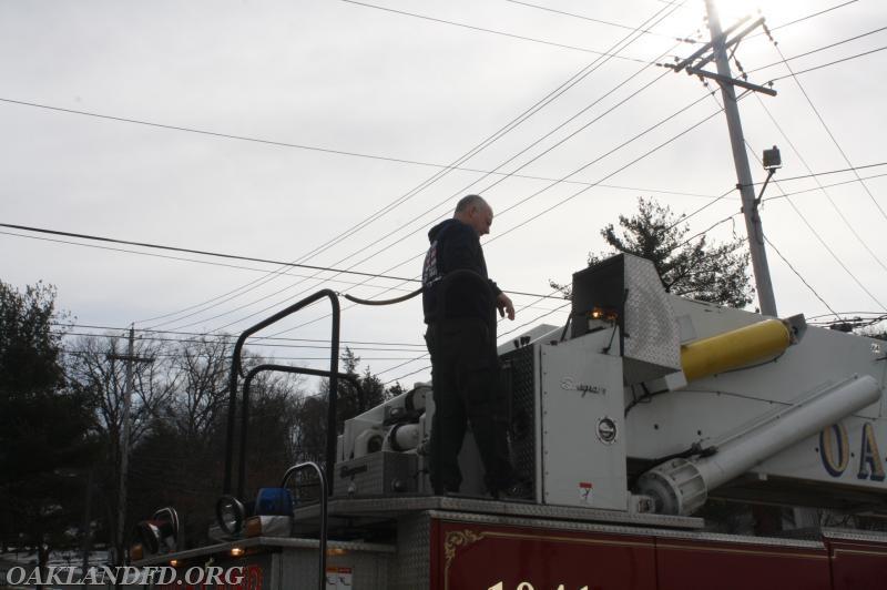 Firefighter Lee Dodd getting the Ladder truck ready for demonstration