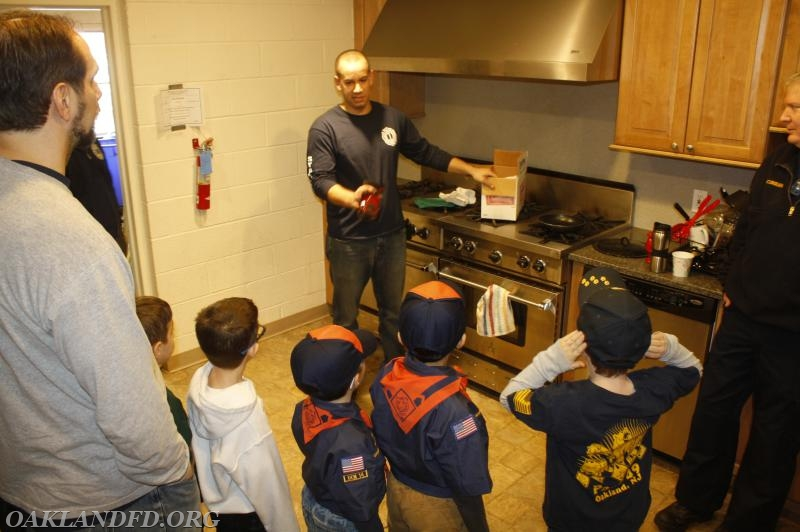 Firefighter Jeff Binder talks to the Tiger Cubs about kitchen safety