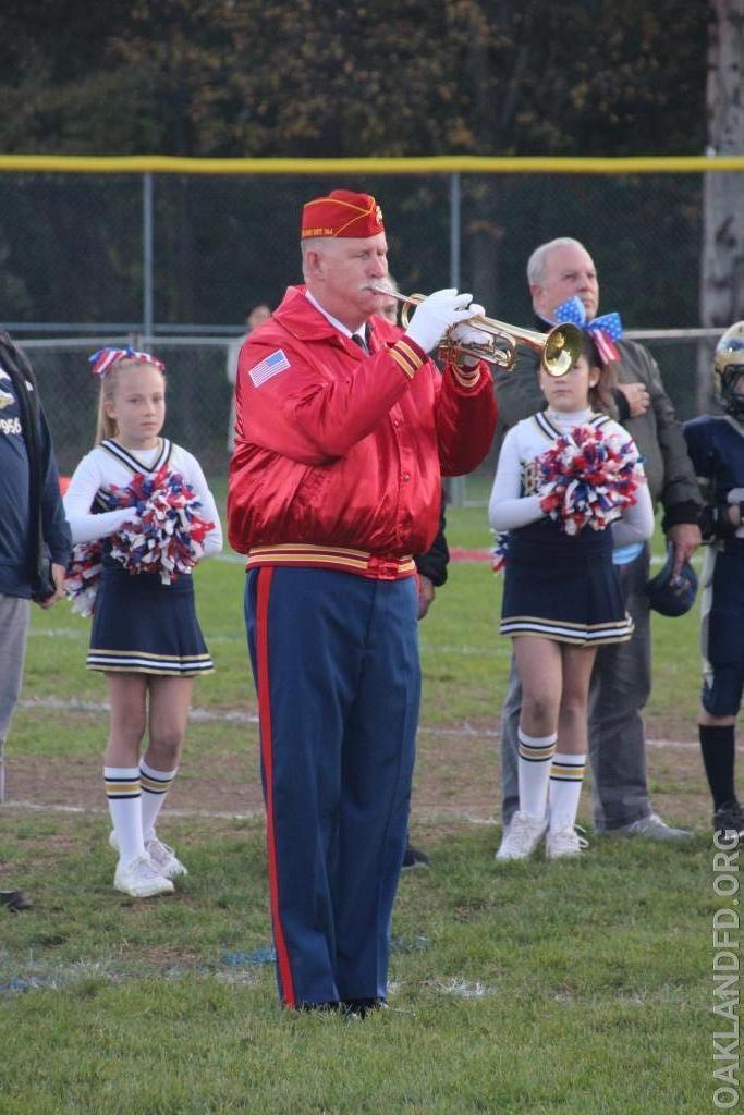 Quartermaster Ken Gysbers plays the bugle