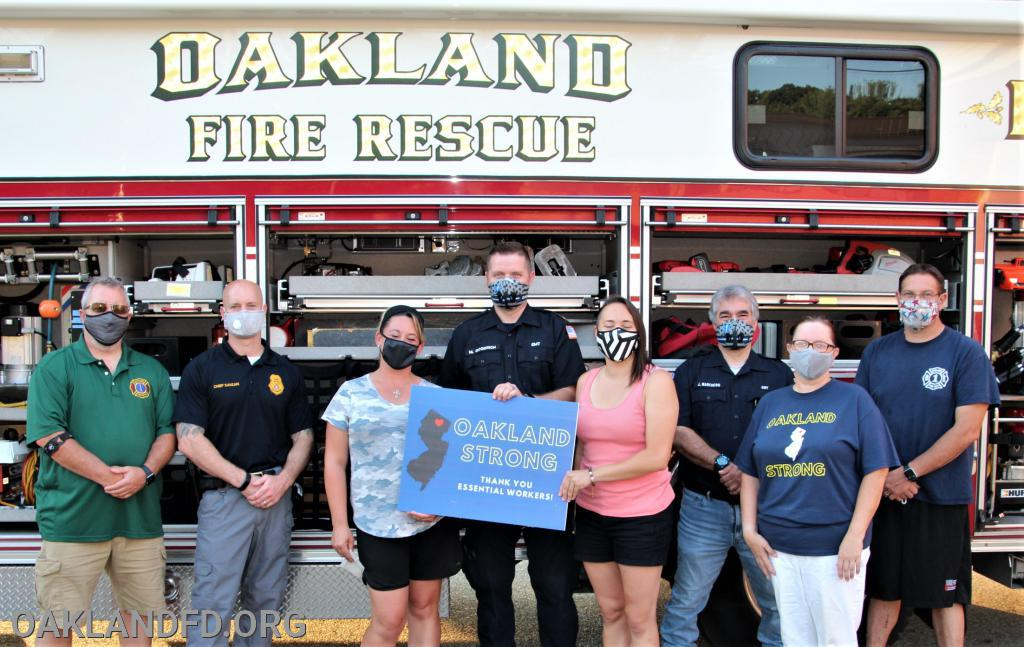 Pictured with the Oakland Strong group of Elizabeth Benducci, Laura Santimauro and Courtney Zizzo are Councilman Robert Knapp, Police Chief Keith Sanzari, First Aid Chief Matt Goodrich, First Aid Asst. Chief Jeff Marcheso and Fire Dept. Chief Vinny Dies.